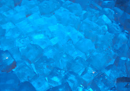 close up of ice cubes lit by blue light