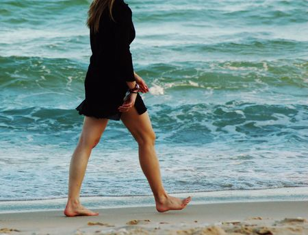 woman walking on beach Stock Photo - 1809888