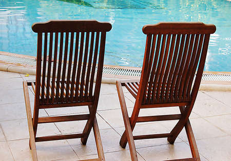 two chairs at poolside