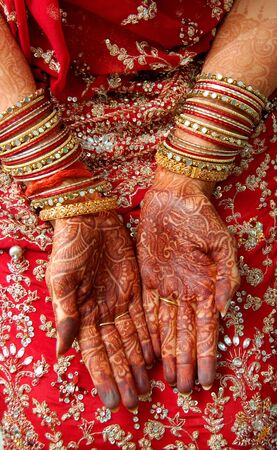 mughal: hands of an indian bride decorated with henna