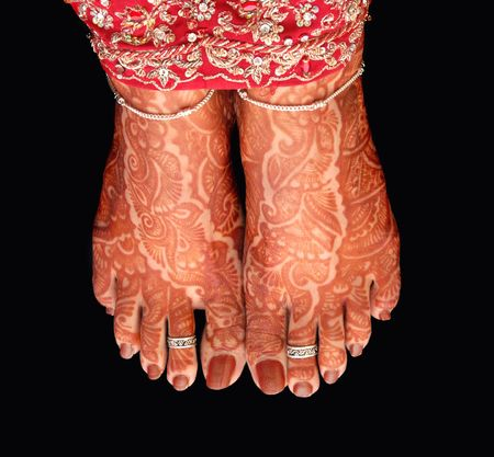 mehndi:   a brides feet decorated with henna