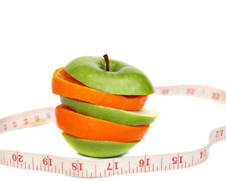 fitness concept-  slices of apple and orange and tape measure