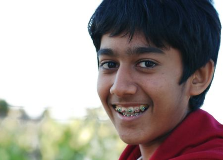 cute braces: a young boy with braces