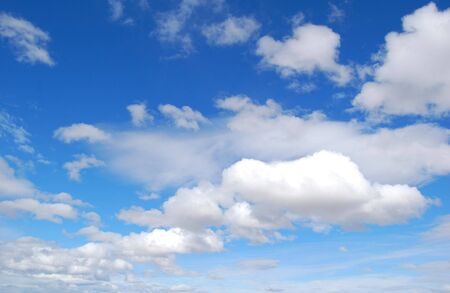 fluffy clouds on blue sky Stock Photo