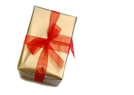 goodie: a gift box with red ribbon over white background with copyspace