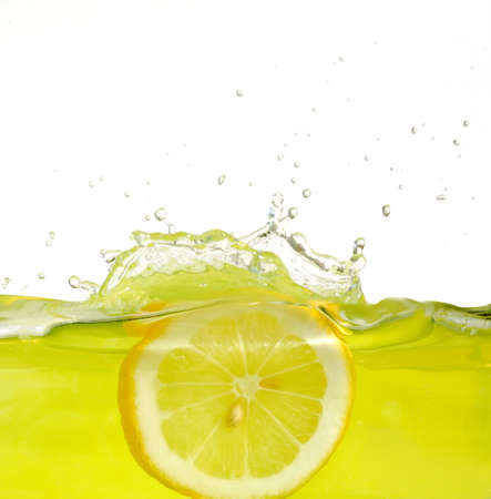with lemon: Image of lemon slice falling into juice