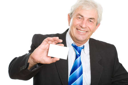 Senior businessman with his card on a white background photo