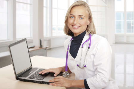 The beautiful woman the doctor on a workplace Stock Photo