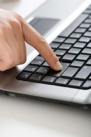 Close-up of human finger pressing  the button - enter Stock Photo - 4150058