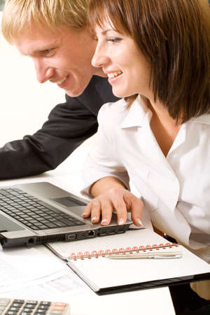 Confident business people doing some computer work together Stock Photo - 4143283