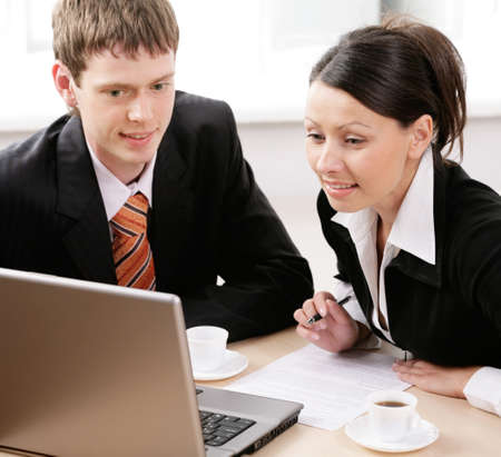 Portrait of two businesspeople working together photo