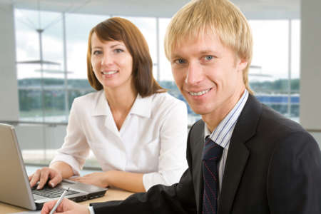 Business team formed of two young people: man and woman photo