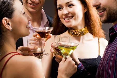 Adults enjoy alcoholic beverages Stock Photo