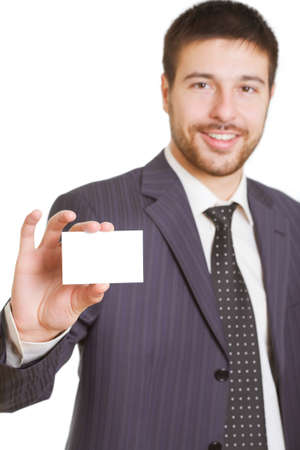 Portrait of  businessman in suit holding his visiting card  photo