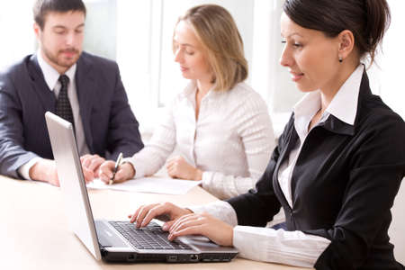 Image of businesswoman typing a letter on the background of people  photo