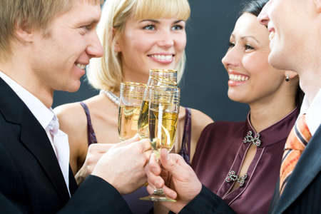 Two young happy smiling couples with champagne glasses Stock Photo