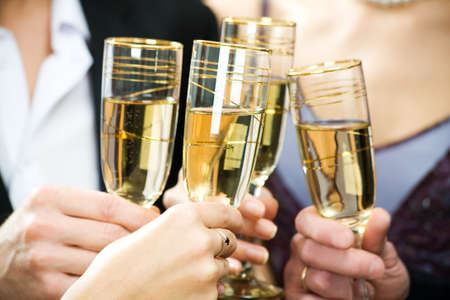 Hands holding the glasses of champagne making a toast Stock Photo - 4162179