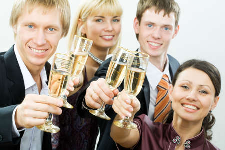 Young adults have a good time with tumblers with champagne photo