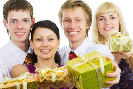 Smiling friends with gift and boxes photo