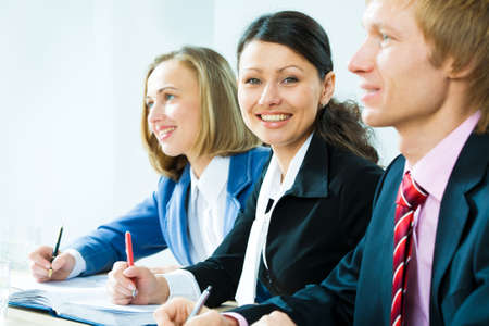 Two businesswomen and a businessman working in team photo
