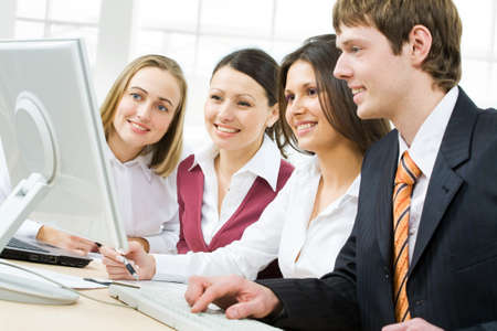 Portrait of four businesspeople discussing computer work Stock Photo - 4162159