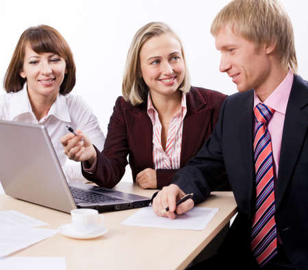Business people sit at à table and communicate Stock Photo - 4207644