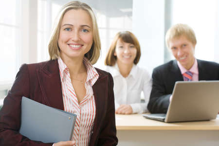 Focus is on the businesswoman in front photo