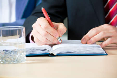 making notes: Businessman making notes Stock Photo