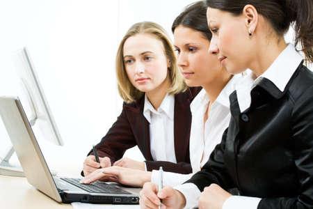 Modern business women at office  photo