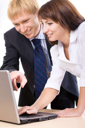 A man and a woman looking at the monitor photo