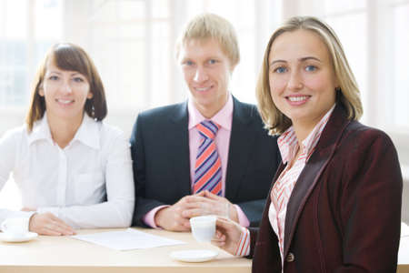 coffeebreak: business team in office Stock Photo