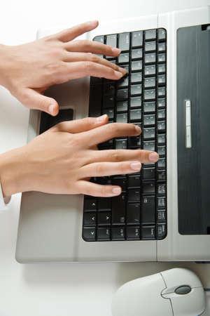 Vertical image of human hands doing some computer work Stock Photo - 4231328