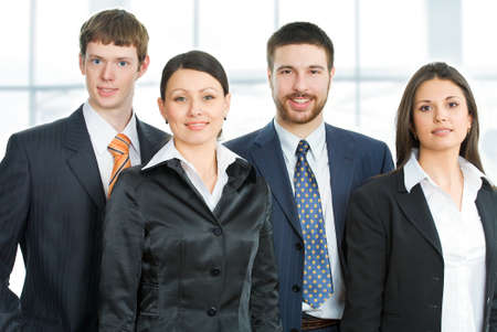 businessteam: Young businessteam standing in a modern office Stock Photo
