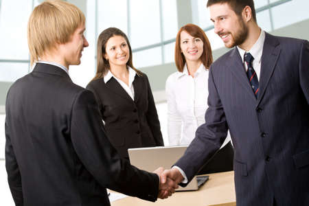 Business people greeting each other before meeting photo