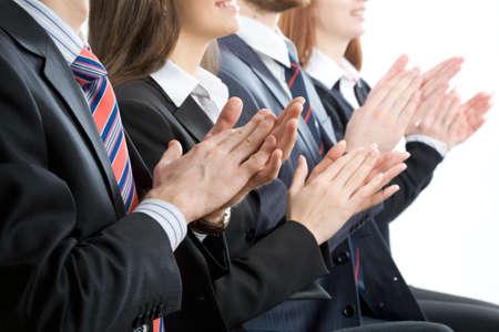 applaud: Happy business people applaud
