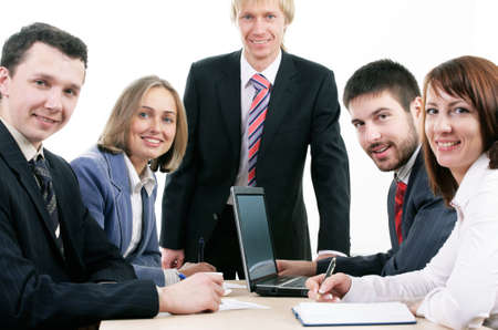 Three sitting businesspeople looking at camera photo