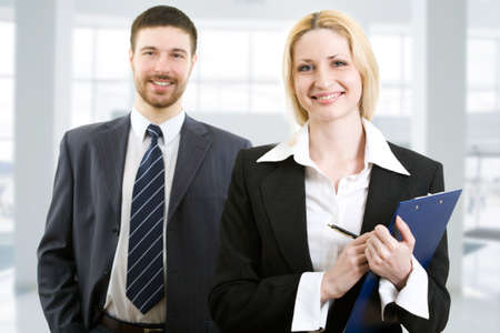 Portrait of two happy business people standing together in office Stock Photo - 4765445