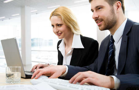 Two businesspeople work in team Stock Photo - 4765446