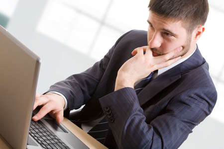 place of research: Businessman using lap-top Stock Photo