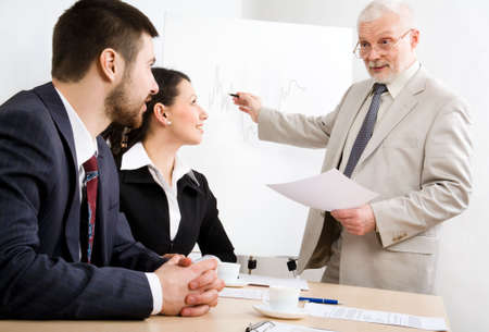 Image of business people listening their boss at seminar Stock Photo