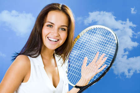 A portrait of a beautiful happy tennis player