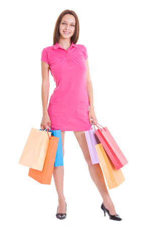 Beautiful young woman with full shopping bags photo