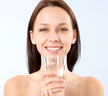 shot glasses: a beautiful young woman holding a glass of water
