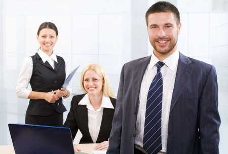 Business people working. Focus is on the man in front Stock Photo - 6666302