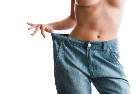 Woman showing how much weight she lost. Healthy lifestyles concept Stock Photo - 6698712