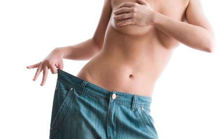 Mulher que mostra o quanto ela perdeu peso. Conceito de estilo de vida saud?vel Imagens