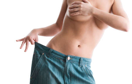 waist down: Woman showing how much weight she lost. Healthy lifestyles concept  Stock Photo