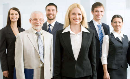 Group of happy business people standing together photo