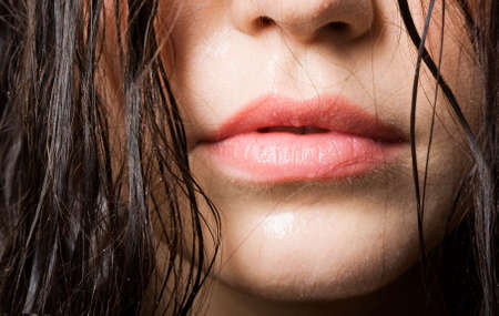 Close up of the beautiful and sexual woman with sensual lips and wet hair Stock Photo - 6782488