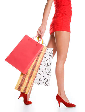 Waist-down view of woman carrying shopping bags Stock Photo - 6791540